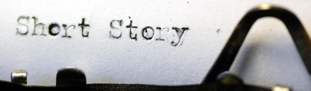 The words 'short story' picked out on a grungy old typewriter. Macro image.
