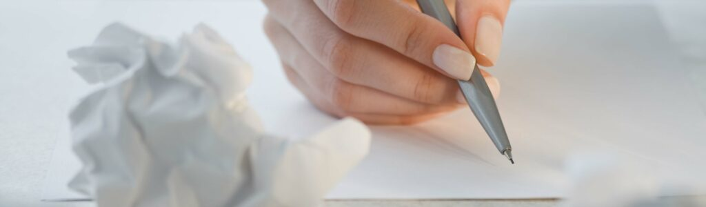 author writing on paper